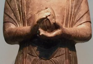 Statue of a Gandaharan Buddhist monk in the Smithsonian, Washington, DC, holding something in his hands